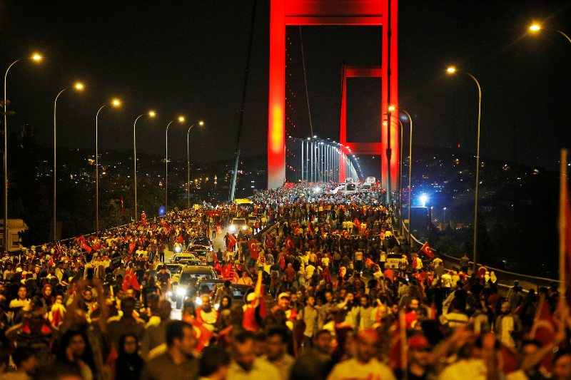 Pro-government supporters protest on Istanbul's iconic Bosporus Bridge, late Thursday, July 21, 2016. Turkish lawmakers approved a three-month state of emergency, endorsing new powers for Turkey's President Recep Tayyip Erdogan that would allow him to expand a crackdown that has already included mass arrests and the closure of hundreds of schools, in the wake of the July 15 failed coup. (AP Photo/Emrah Gurel)